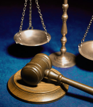 Gavel next to the Scales of Justice